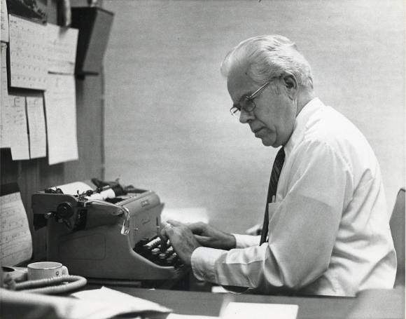 RICHARD ROSS PREPARING HIS NEWSCAST