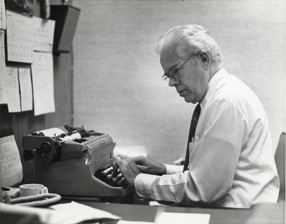 RICHARD ROSS PREPARING HIS NEWSCAST